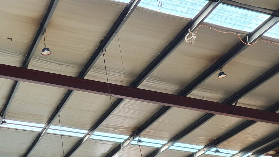 New Skylight Roof Panels Allowing Greater Light into Warehouse
