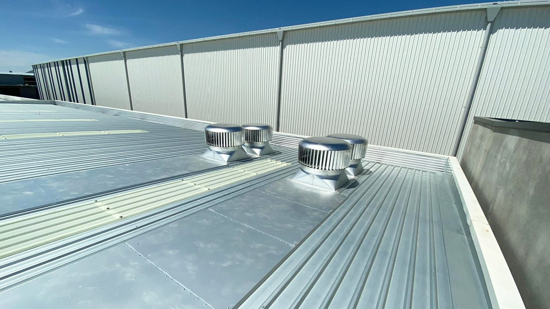 Rotary Vents with Back Trays on Warehouse Roof